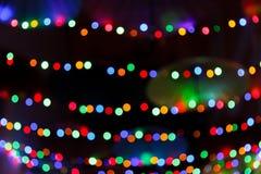 提取与回合行,光芒四射的多彩多姿的光的被弄脏的背景 免版税图库摄影