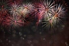 提取与bokeh的色的烟花背景在新年费斯特 免版税图库摄影