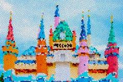 提取五颜六色的与蓝天的动画片五颜六色的城堡的彩色玻璃图象 库存图片