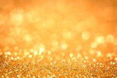 提取假日背景的金光 免版税库存照片