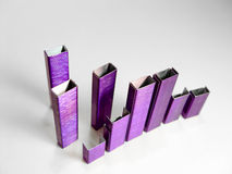 提取紫色钉书针 库存照片
