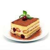 提拉米苏蛋糕部分在空白牌照的 库存图片