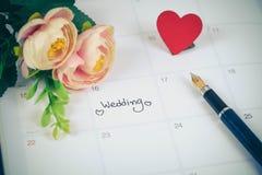 提示在日历计划的婚礼之日 免版税库存图片