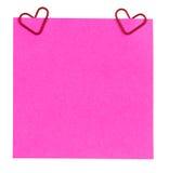 提示纸和夹子以被隔绝的心脏的形式 免版税库存图片