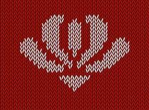 提花织物编织了与白花的样式在红色背景 库存照片