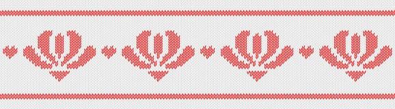 提花织物羊毛编织了与红色花的样式在白色背景 库存照片