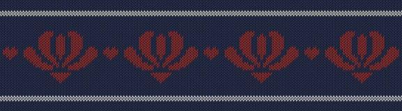 提花织物羊毛编织了与红色花的样式在蓝色背景 免版税图库摄影