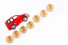 提高并且降低车的白色背景的价值 免版税库存图片
