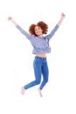 提高胳膊和跳跃的黑人愉快的非裔美国人的女孩 库存图片