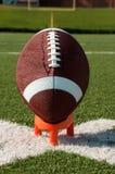 插入发球区域的美国特写镜头橄榄球 免版税库存图片