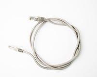 插接线与被铸造的RJ45插座的网络缆绳,隔绝在白色背景 免版税图库摄影