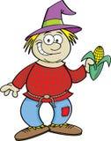 握一个玉米穗的动画片稻草人 库存照片