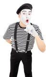 握在嘴唇的男性喜剧演员手指 库存照片