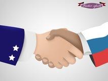 握在amarican人和rusian人之间的手 免版税库存图片