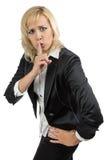 握她的手指的女商人在嘴附近 库存照片