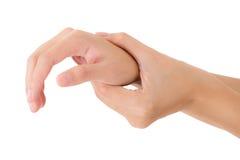 握她美丽的健康腕子和按摩在痛苦区域的妇女 免版税库存照片