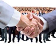 握手和企业队 库存照片