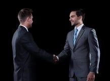 握手商务伙伴在会议上 免版税库存照片