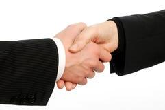 握手在交易的公和女性董事特写镜头  免版税图库摄影