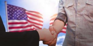 握手的公司男人和妇女的综合图象 免版税库存图片