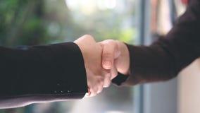 握手的商人以后做生意 概念o 免版税库存照片