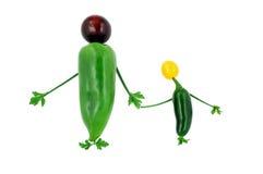 握手的愉快的健康菜家庭 库存照片