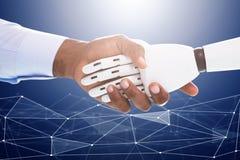 握手的机器人和商人 图库摄影