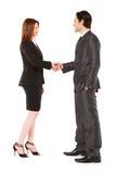 握手的生意人和女实业家 库存图片