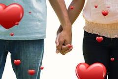 握手的年轻夫妇的综合图象在公园 免版税库存照片
