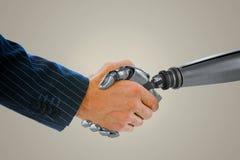 握机器人的手的商人的综合图象 免版税库存图片