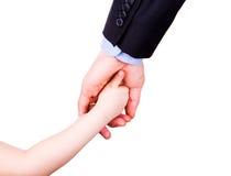 握父亲的手的孩子。 信任、togethterness和支持概念。 库存照片