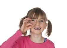 握缺掉牙的微笑的女孩 图库摄影