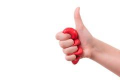 握紧在拳头在白色背景的女孩红色软泥 库存图片