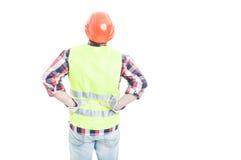 握他的在更加低后的男性工程师手 免版税图库摄影