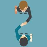 握他们的手的两个人顶视图  免版税库存图片