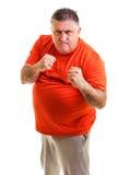握紧他的拳头的愤怒的人准备好战斗 免版税图库摄影