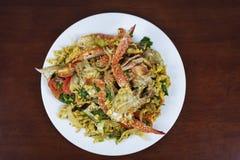 搅动与咖喱粉,泰国食物的油煎的螃蟹 免版税库存照片