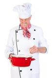 搅动在平底锅的厨师 免版税库存图片