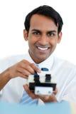 搜索微笑的生意人索引 免版税库存照片