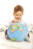 搜寻在世界地球的男婴 库存照片