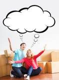 搬到一个新的家的年轻夫妇 免版税图库摄影