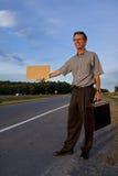 搭车的生意人工作 免版税库存图片