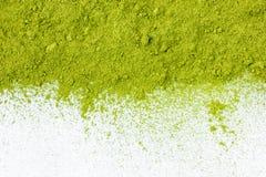 搽粉的绿茶顶视图关闭边界  免版税库存照片