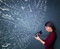 摄影师射击图象,当时精力充沛的手拉的线 免版税图库摄影