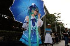 摄影师射击cosplay女孩 免版税库存图片