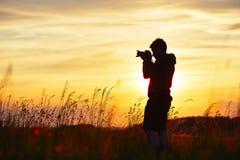 摄影师的剪影 免版税库存图片