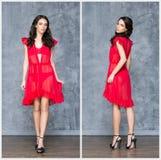 摆在一件红色礼服的性感的妇女 免版税库存照片