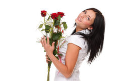 摆在与一朵红色玫瑰的少妇查出 库存图片