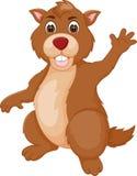 摆在与微笑和挥动的滑稽的土拨鼠动画片 免版税库存照片