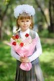 女小学生第一辆平地机 免版税库存图片